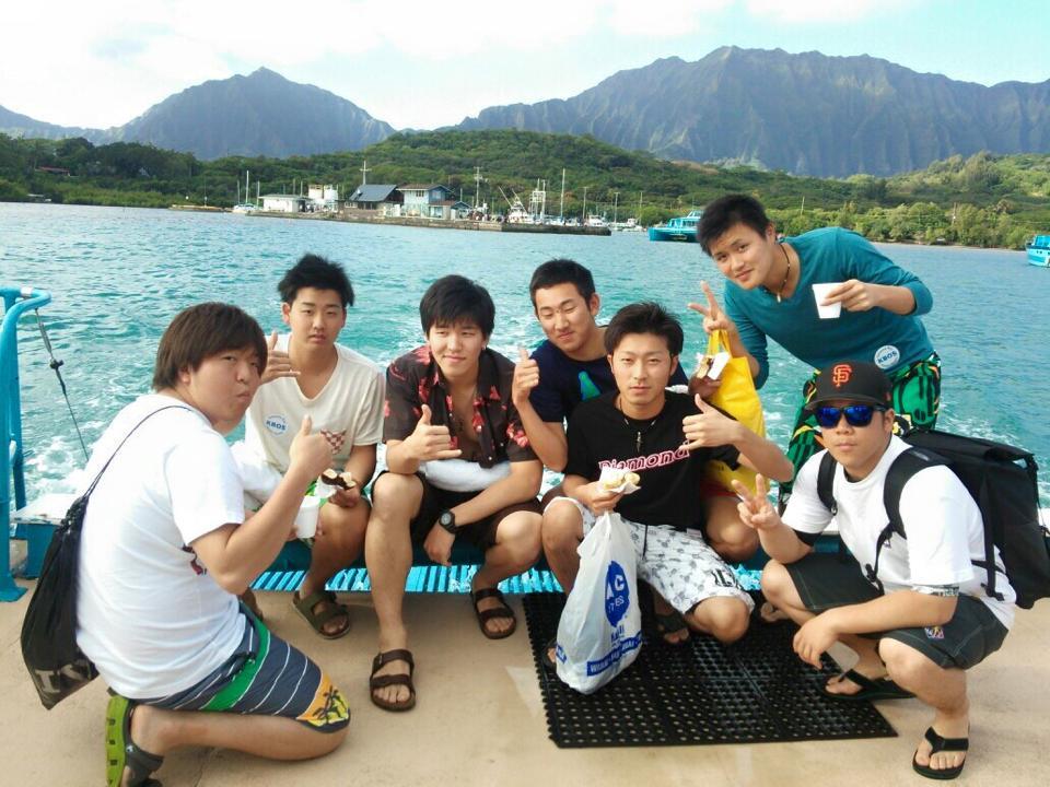 五十嵐亮介さん(写真右上、緑のTシャツ)